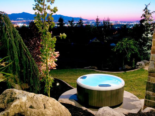 Bullfrog Spa in backyard with city view