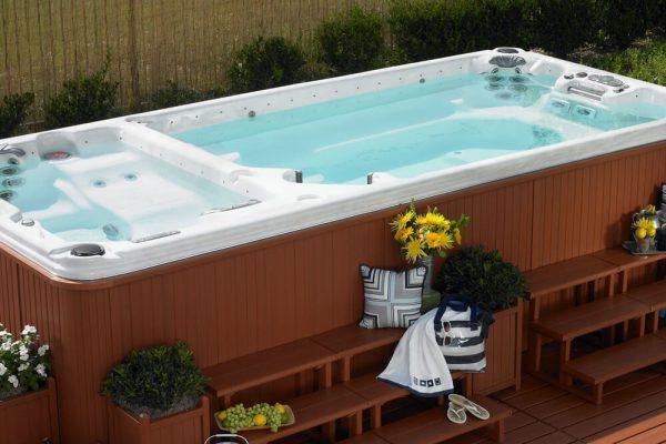 CalSpa swim spa with matching wood steps