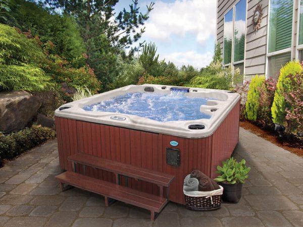 CalSpa hot tub in backyard