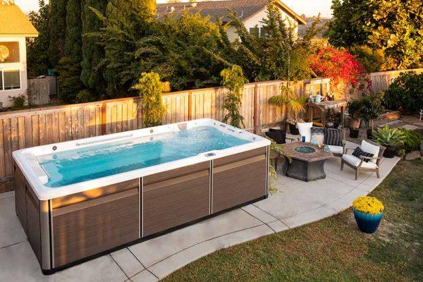 Endless Pool swim spa next to firepit