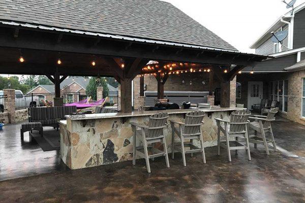 Endless Pool swim spa next to backyard kitchen