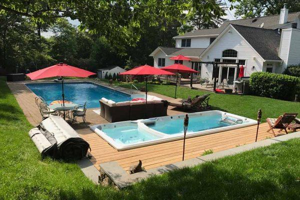 Endless Pool swim spa next to a pool