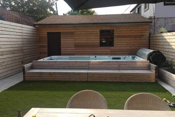 Endless Pool swim spa with matching wood steps