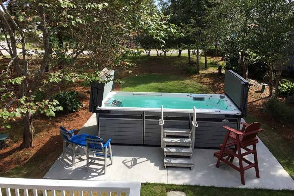 Endless Pool swim spa with steps and cover