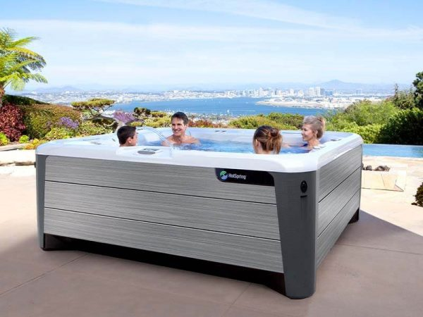 Family in a Hot Spring hot tub with ocean view