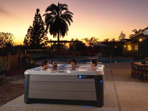 Friends in a Hot Spring hot tub sunset