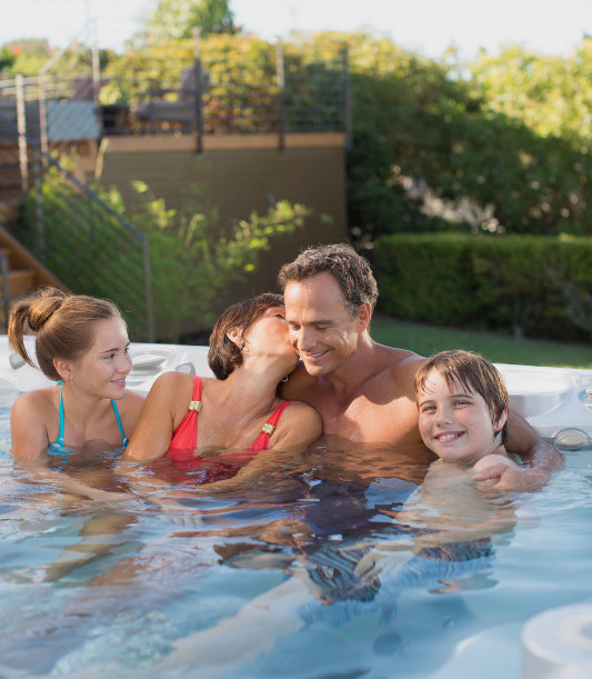 Grandparents with grandkids invest in quality time in a hot tub