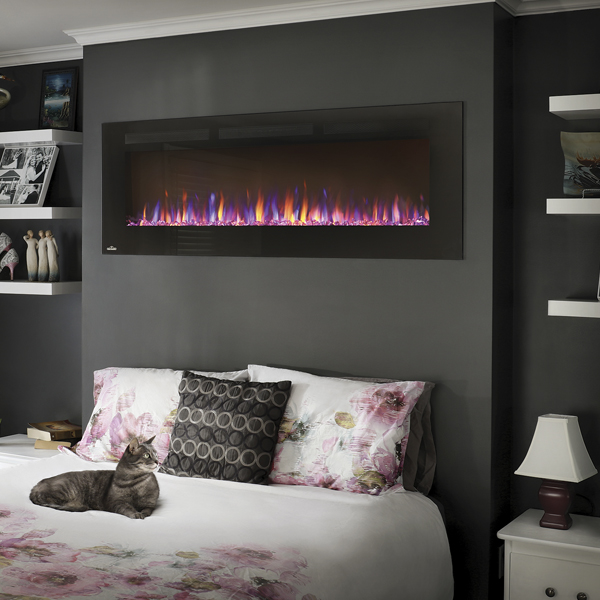 A wall hanging electric fireplace adds warm ambiance to a winter night
