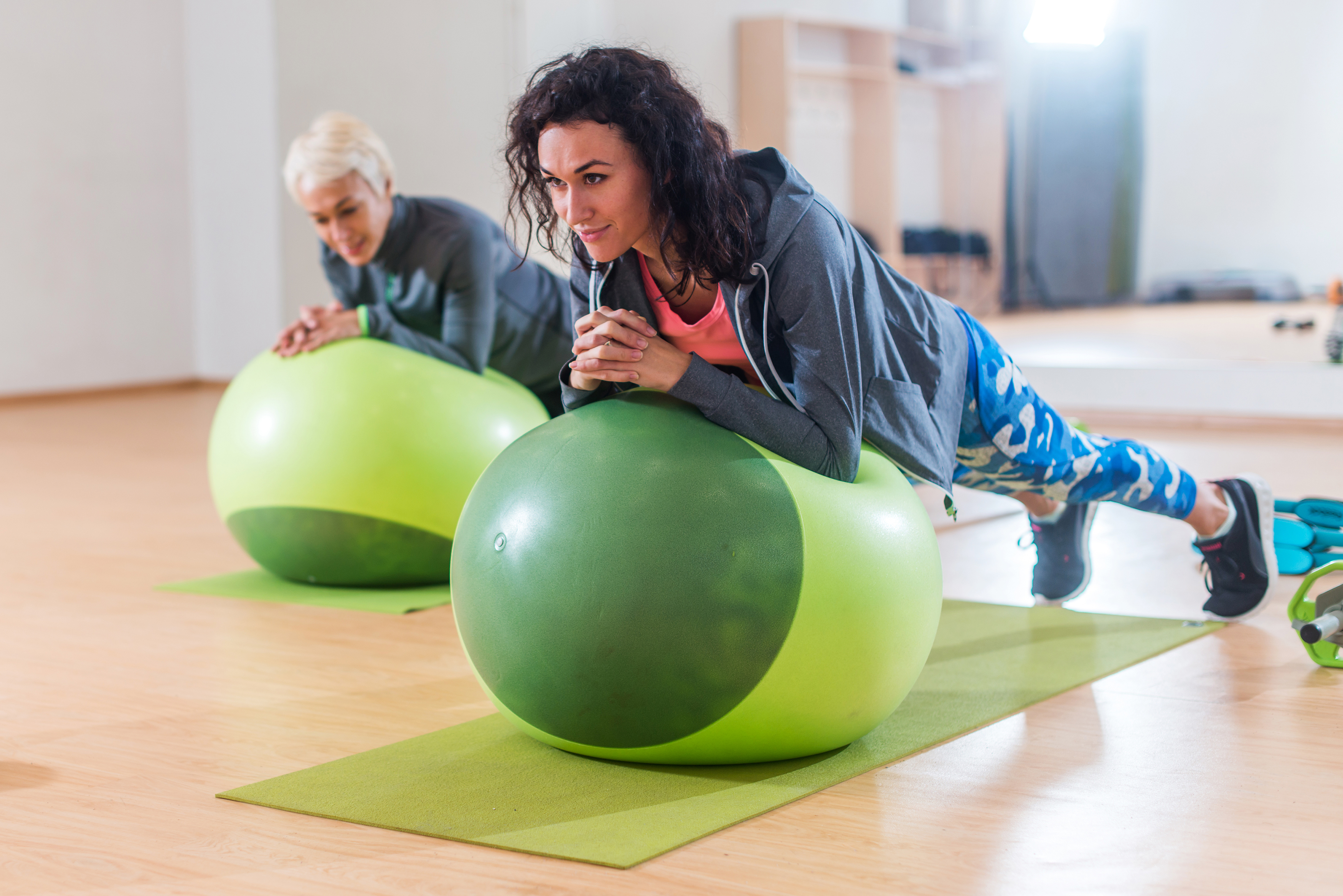 Spice up your workout with a stability ball and weights