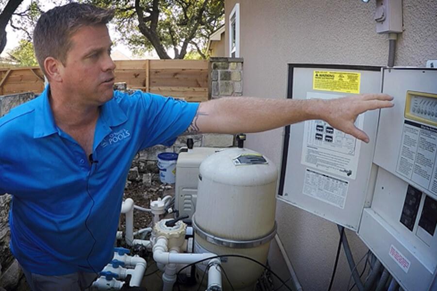 Man Servicing Pool Filter Beecave, Texas