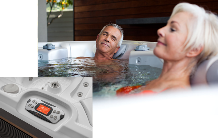 Couple in a Caldera Spa featuring positive Hot Tub Reviews