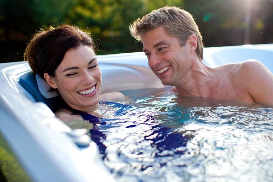 Couple enjoying salt water hot tub in daytime