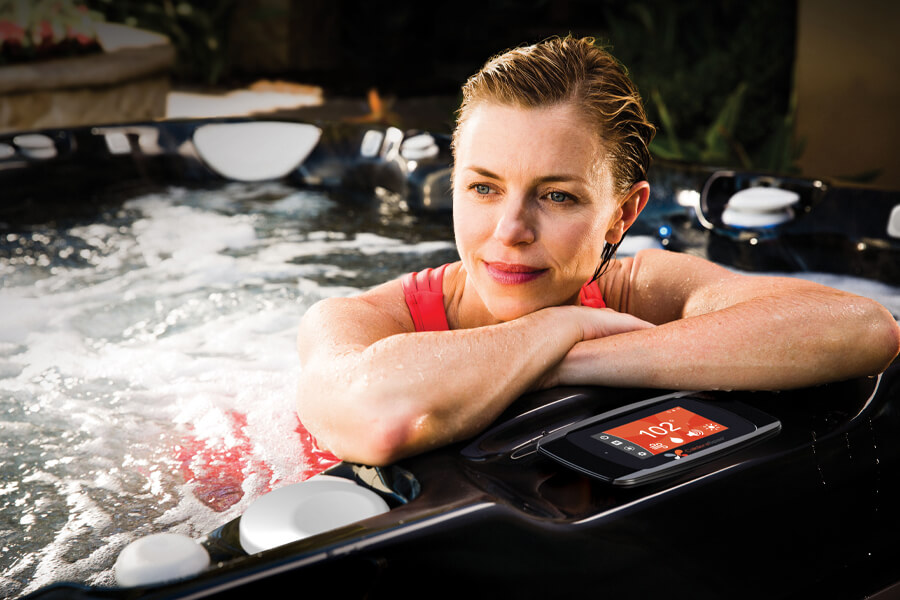 Woman in black color hot tub that features advanced control