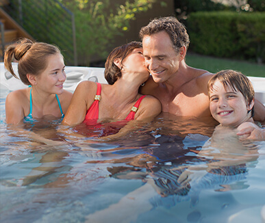 family in caldera hot tub
