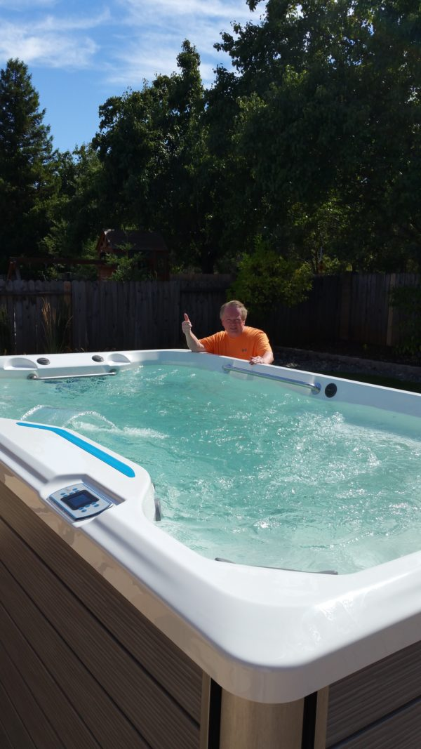 Man enjoying affordable swim spa delivery