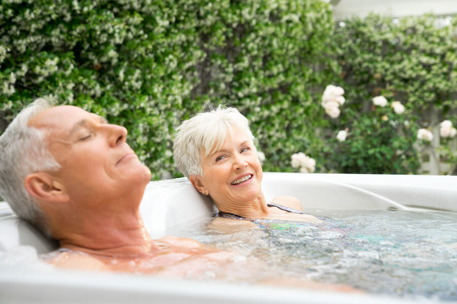 Older couple relaxing in a salt water hot tub