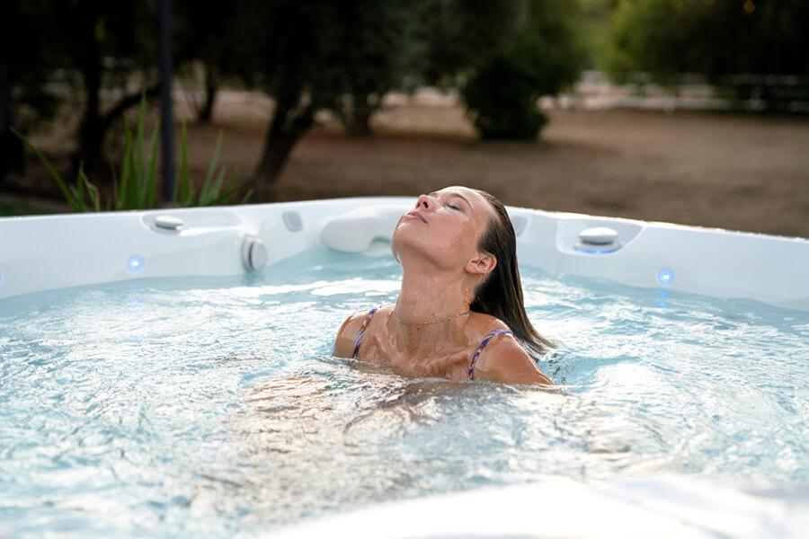 Woman soaking in a salt water hot tub
