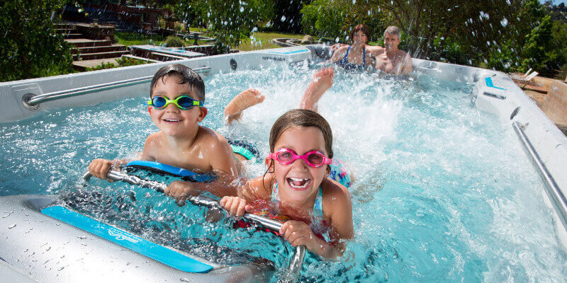 kids playing in an affordable swim spa