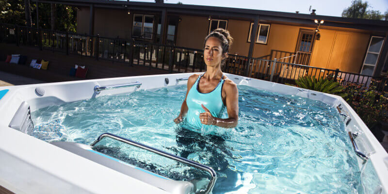 Woman jogging in an affordable swim spa