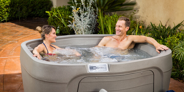 Couple soaking in FreeFlow spa after delivery
