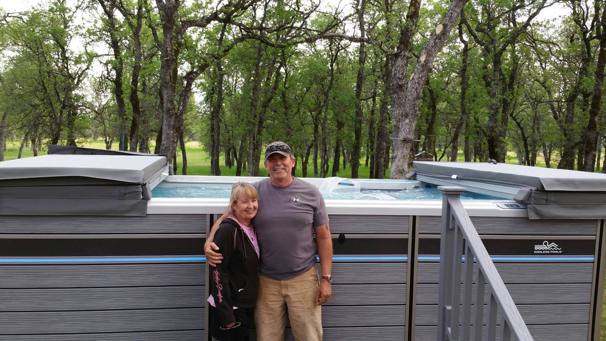 Customers smiling with their hot tub delivery