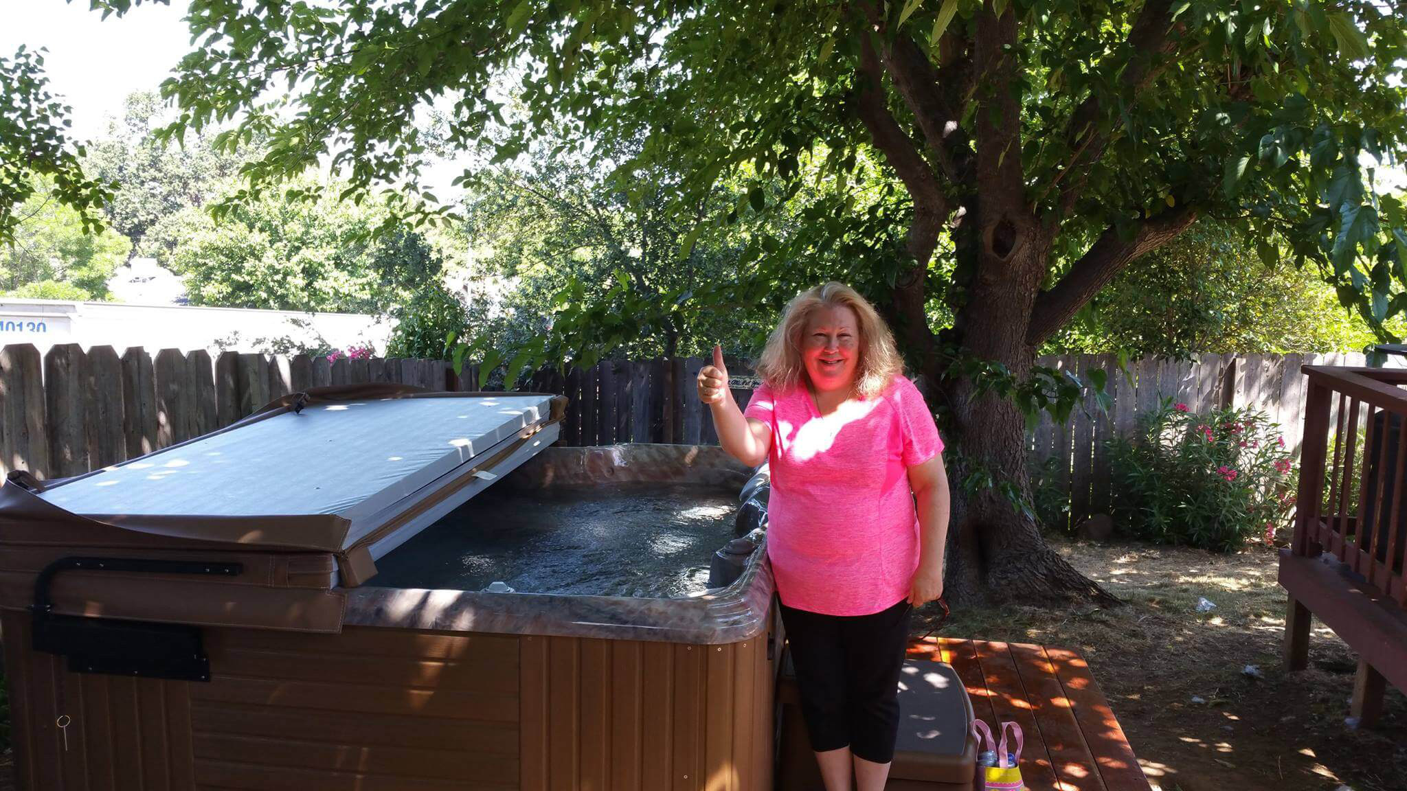 Woman smiling with her hot tub delivery