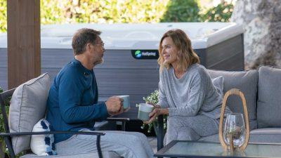 HotSpring-Highlife-2020-Vanguard-AlpineWhite-Driftwood-Lifestyle-Couple-OutsideOfSpa-MorningCoffee.jpg