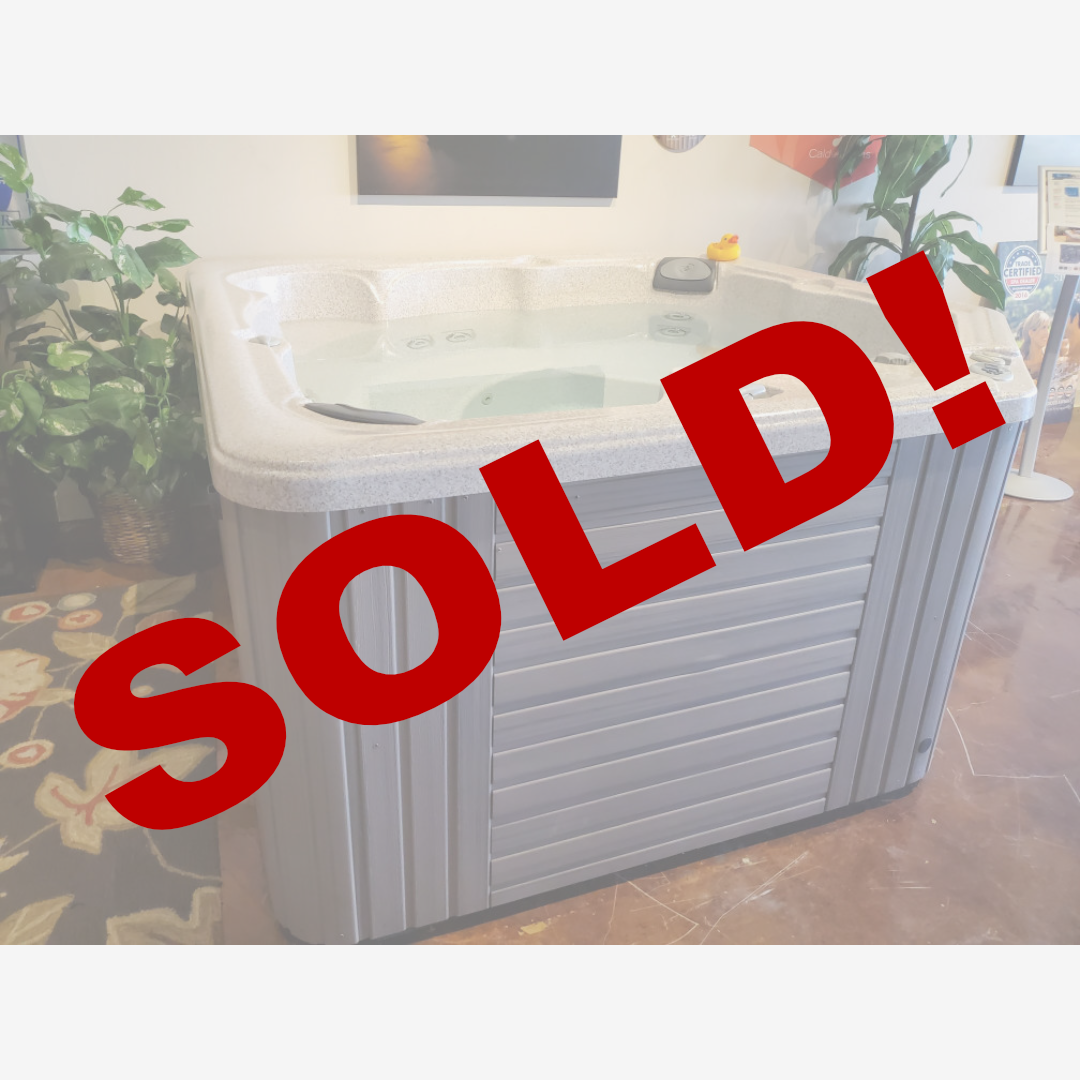 Caldera hot tub with gray cabinet and white shell @ Sweetwater Hot Tubz SOLD