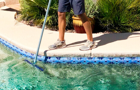 Man cleaning a swimming pool in Tucson
