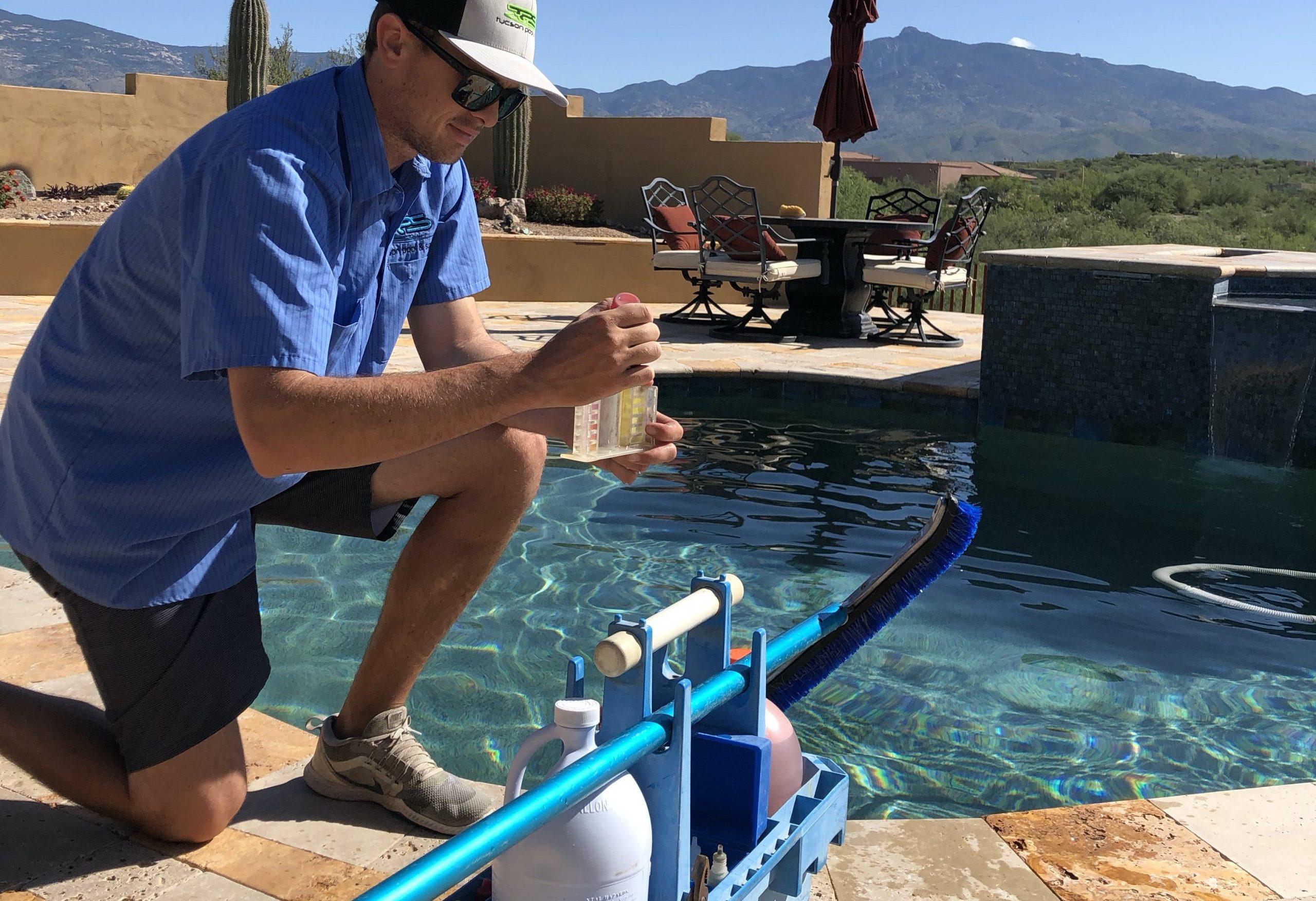 Man testing pool water