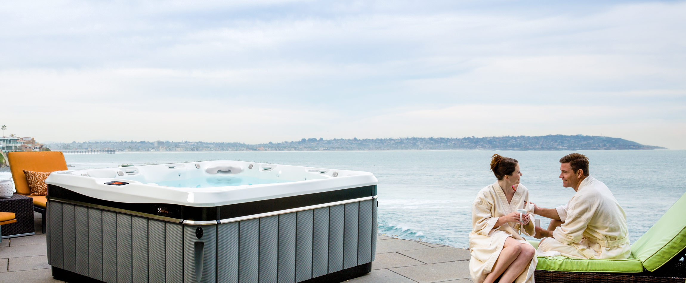 Couple next to hot tub by the sea