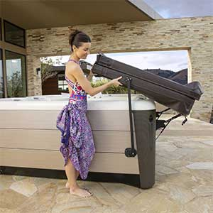 spa cover lifting woman