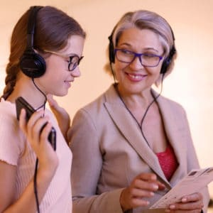 Mother and daughter listening to audio tour