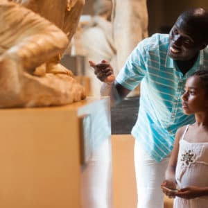 Father and daughter at museum