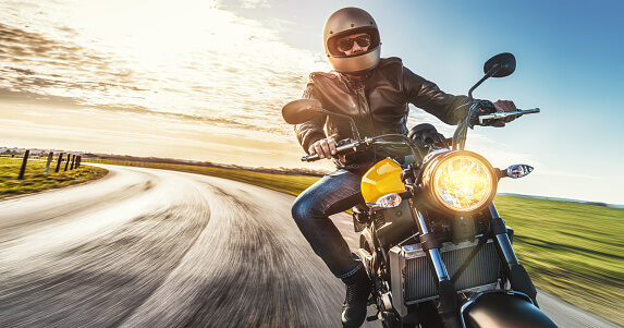 Motorcycle rider going around a curve