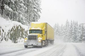 Truck driving through winter conditions
