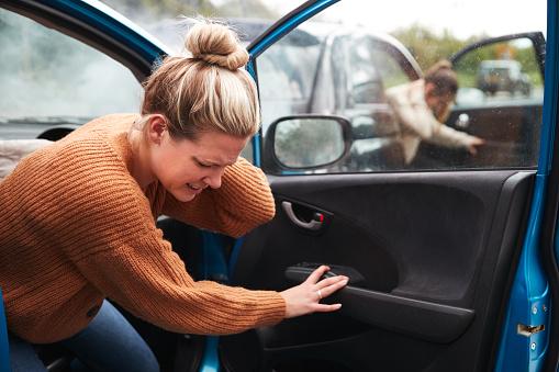 Female motorist In crash holding neck in pain