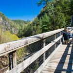 Heidi shows Trey the view from the suspension bridge across Tallulah Gorge