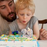 Trey helps Daddy blow out his candles