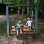 Trey and Kenny enjoy a swing