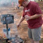 Christian Lineberger of Macon, GA grills burgers at the Hauns' celebration cookout at High Falls State Park. William Haun and his 2 year-old son Trey visited all 63 of Georgia's State Parks and Historic Sites from July 2008 to July 2009.