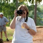 Diane Flynn, VP of the Middle Georgia Camera Club, takes pictures at the Hauns' celebration cookout at High Falls State Park. William Haun and his 2 year-old son Trey visited all 63 of Georgia's State Parks and Historic Sites from July 2008 to July 2009.