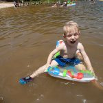 Trey plays in Clarks Hill Lake at Mistletoe State Park