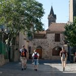 Heidi, Nicholas, and Frederic walk through the village of St. Mathieu de Treviers on their way up to Pic St. Loup