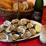 It's all about the presentation... oysters, white wine, and grattons de canard (a chunky pate made of duck fat)