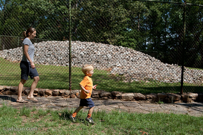 Heidi and Trey head to the tower to look back down at the mound. The 8ft pile of rocks behind them is the effigy mound.
