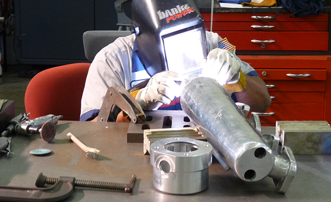 One of this engine's many specially fabricated pieces comes together
