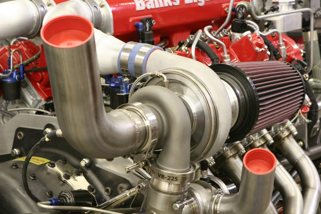 Twin Garrett turbochargers similar to those used on Le Mans racers force air into a custom Banks Big Hoss intake manifold