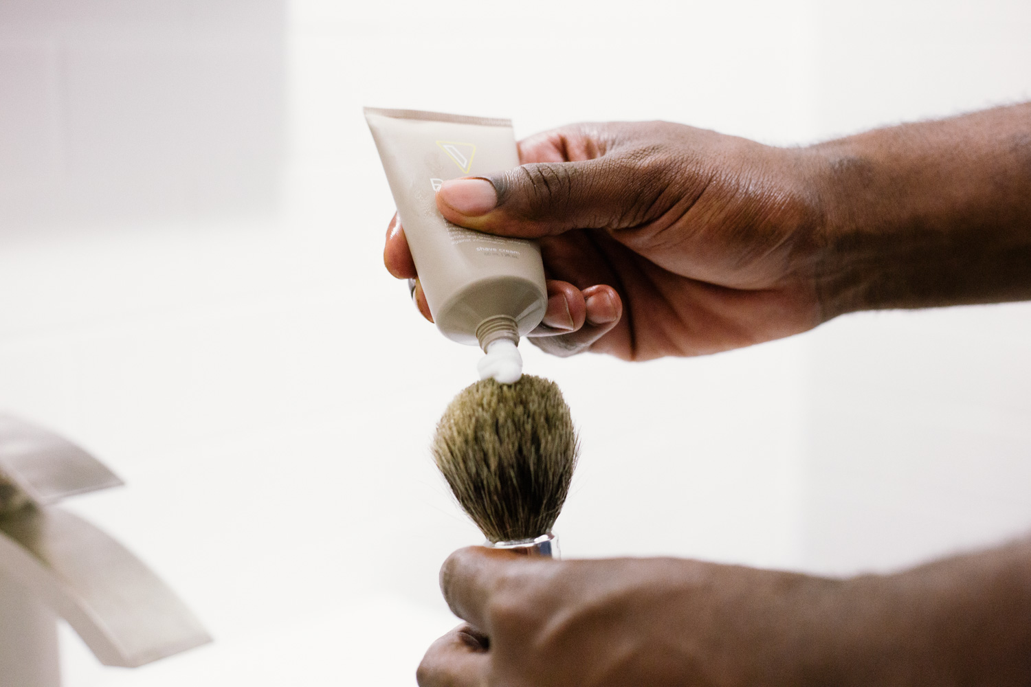 Image of applying shaving cream on brush