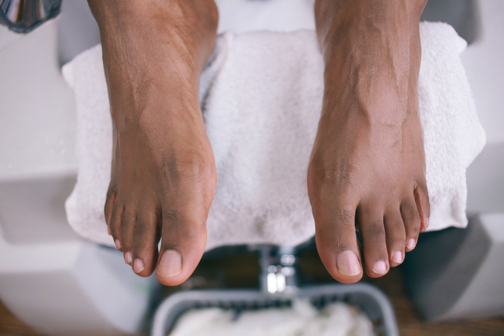Images of Black man's pedicured feet